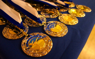Medals laid out on a table at a skating competition